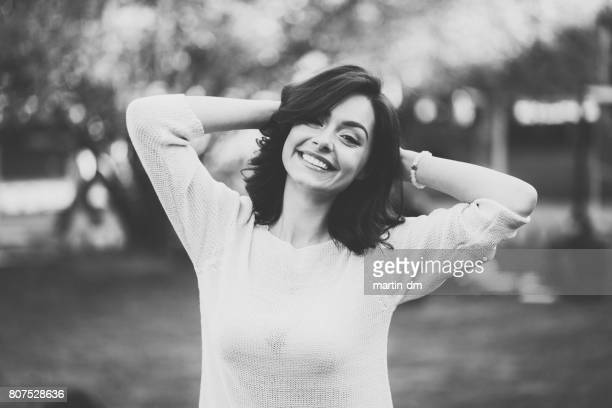 young woman smiling to the camera - martin dm stock pictures, royalty-free photos & images