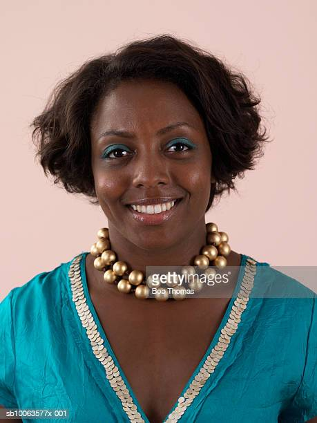 Young Woman Smiling Wearing Gold Necklace, Portrait