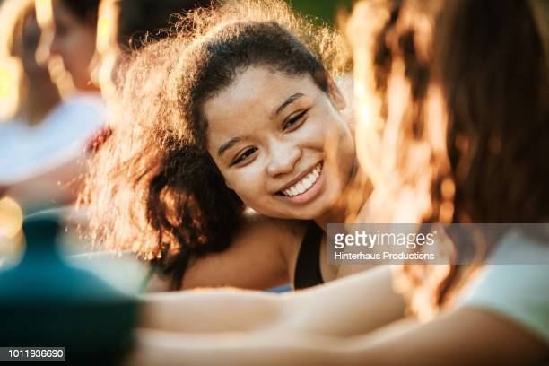 young woman smiling while out with fitness group - vietnamese ethnicity stock pictures, royalty-free photos & images