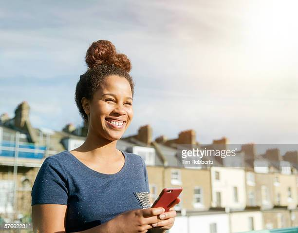 Young woman smiling with smartphone