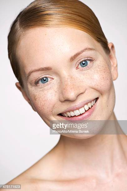 Young woman smilling cheerfully, portrait