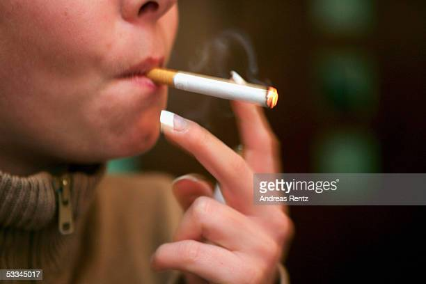 A young woman smokes a cigarette on August 9 2005 in Lueneburg Germany Smokers in Germany must dig deeper into their purses from September as...