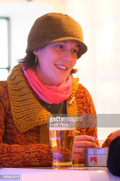 young woman smoking at stereo bar. - harjumaa stock pictures, royalty-free photos & images