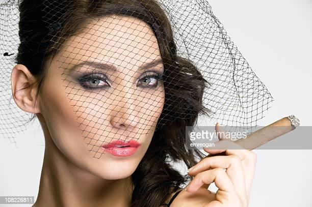 young woman smoking cigar and wearing mesh veil - beautiful women smoking cigars stock photos and pictures
