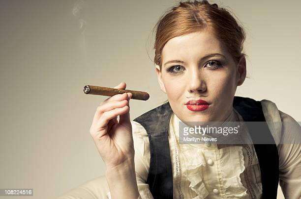 young woman smoking cigar - beautiful transvestite stock photos and pictures