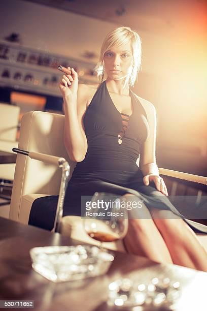 young woman smoking cigar, portrait, dubrovnik, croatia - beautiful women smoking cigars stock photos and pictures