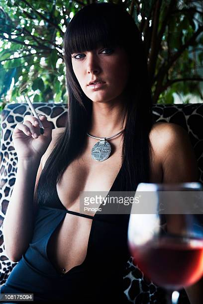 young woman smoking cigarette and drinking wine - beautiful women smoking cigarettes stock photos and pictures