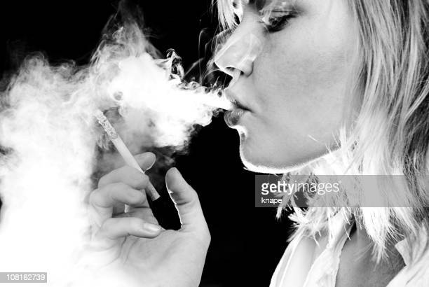 young woman smoking cigarette, black and white - beautiful women smoking cigarettes stock photos and pictures