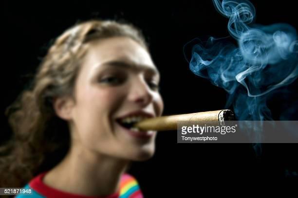 Young Woman Smoking Large Cigar