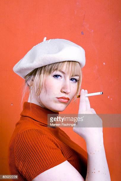 young woman smoking, portrait - ベレー帽 ストックフォトと画像
