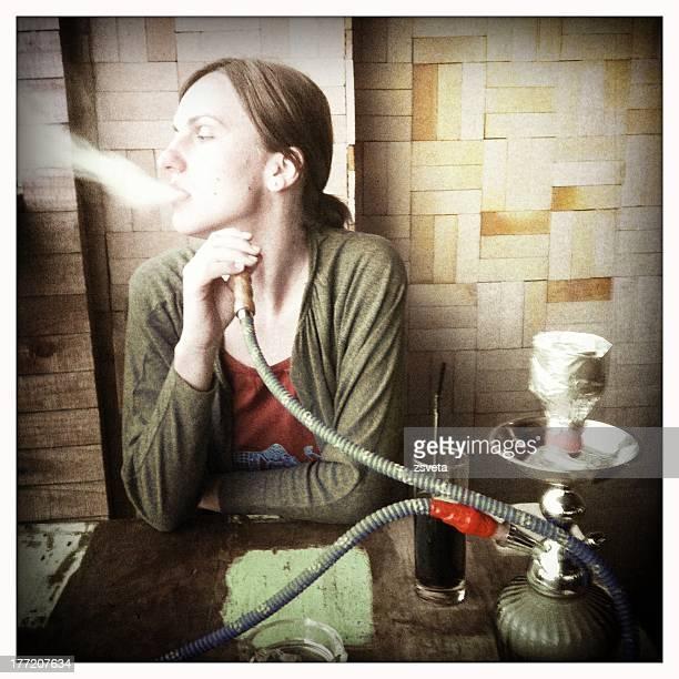 Young woman smoking shisha