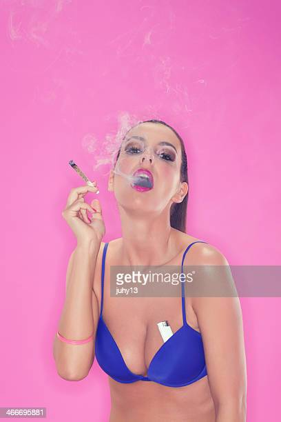 Young woman smoking weed