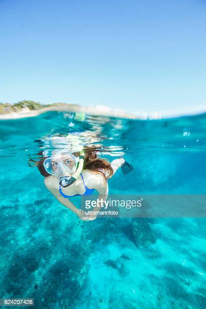 Young woman snorkeling Underwater diving adventure   Turquoise sea lagoon
