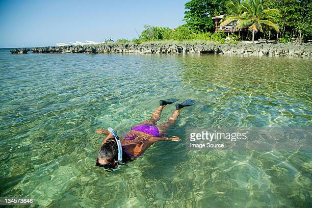 Young woman snorkelling in shallow water
