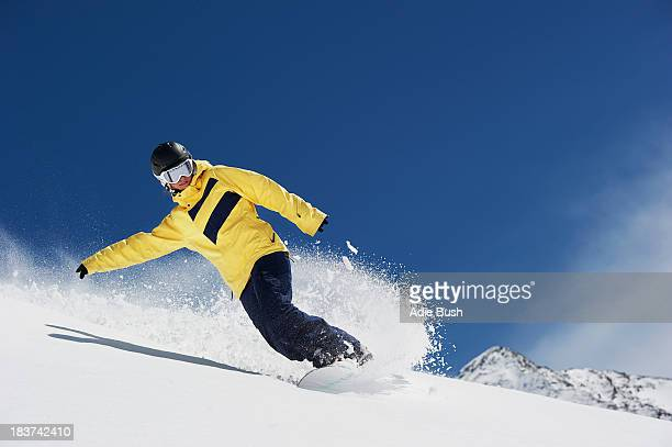 young woman snowboarding - boarding stock pictures, royalty-free photos & images
