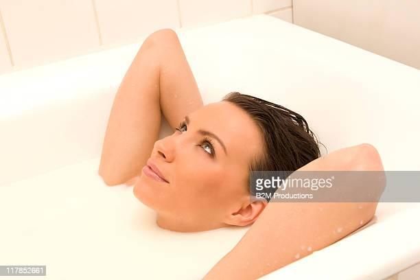 Young woman soaking in Milk bath
