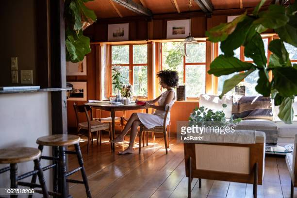 young woman spending a relaxing day in her beautiful home - diary stock pictures, royalty-free photos & images