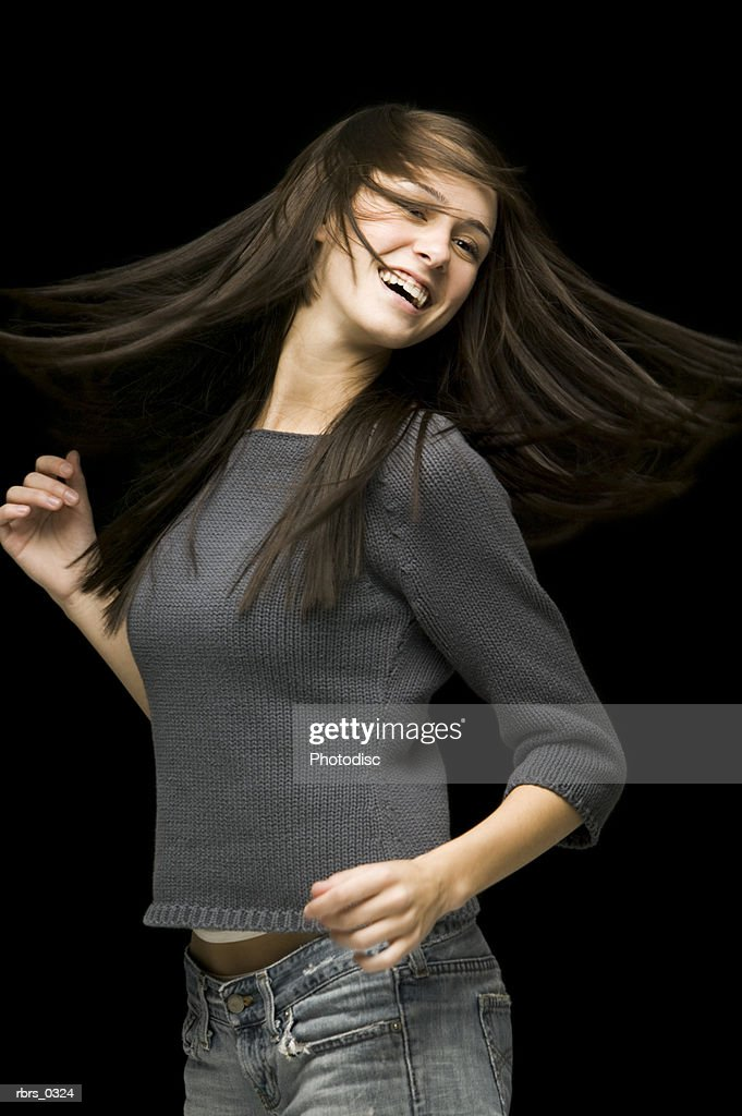 Young woman spinning her hair : Foto de stock