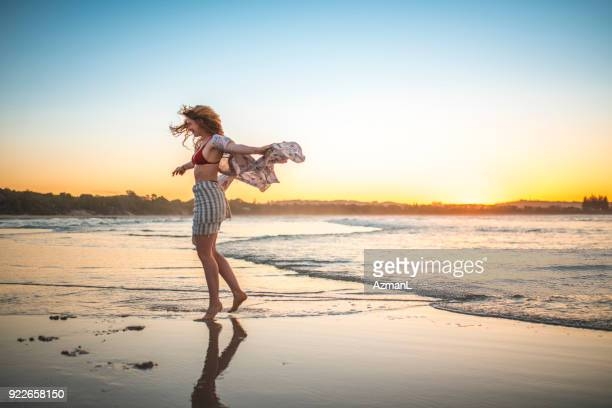 Young woman spinning on the beach