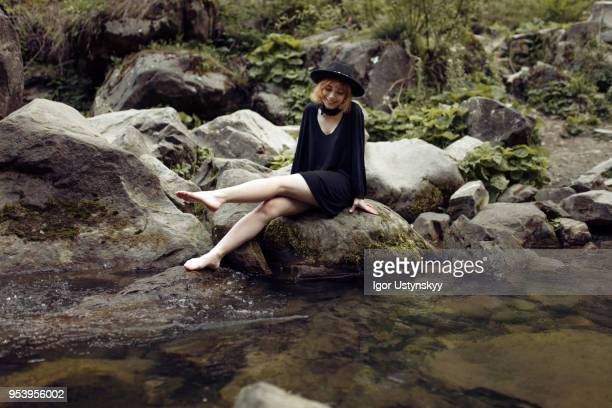 young woman splashing and kicking her legs - pretty white girl feet stock photos and pictures