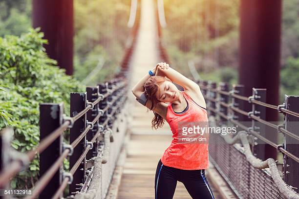 young woman sports training at the rope bridge - individual event stock pictures, royalty-free photos & images
