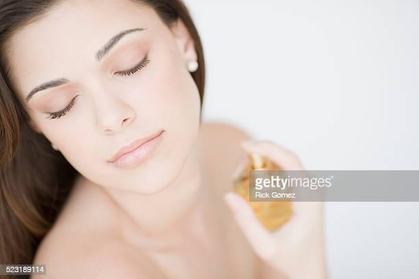 Young Woman Spraying Perfume