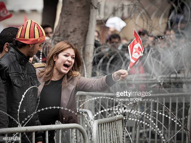 Young woman sreaming in front of Interior Ministry in Tunis after the murder of Chokri Belaid, political opposant killed in Tunis. Protestor against...