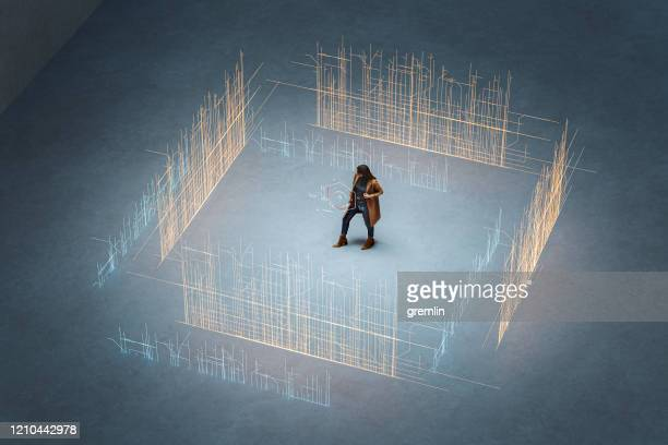 young woman standing against city with augmented reality directions - surrounding stock pictures, royalty-free photos & images