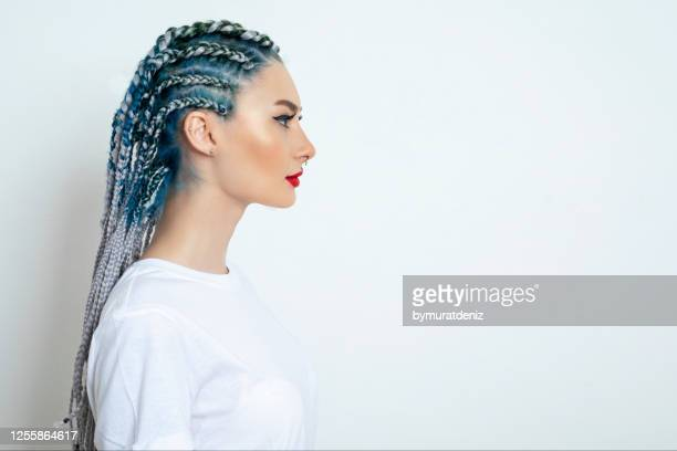 young woman standing and looking - dreadlocks stock pictures, royalty-free photos & images