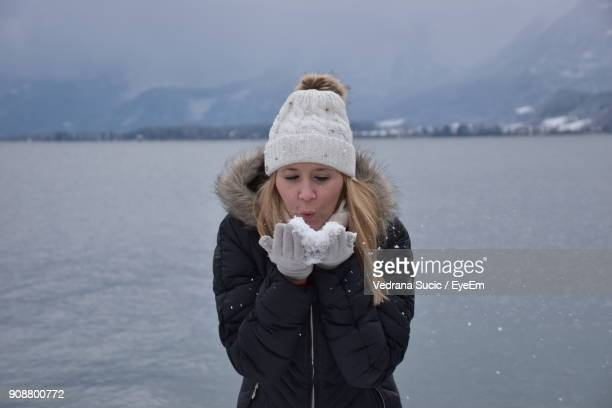 Young Woman Standing At Lakeshore