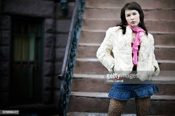 young woman standing at stairs - arrogance stock pictures, royalty-free photos & images