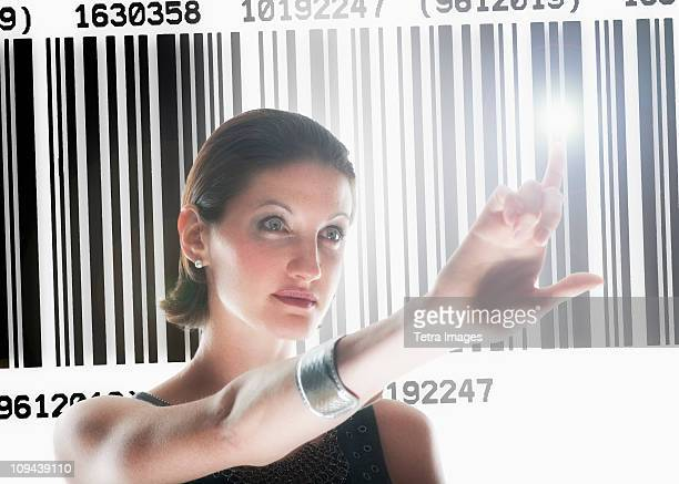 Young woman standing by barcode