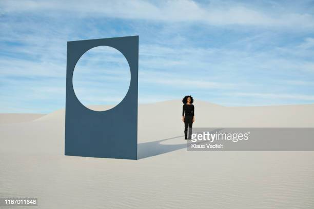 young woman standing by portal at white desert during sunny day - landscape scenery ストックフォトと画像