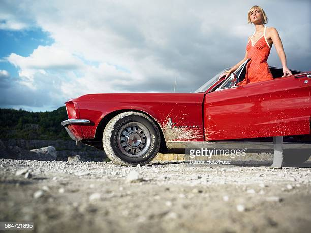 Young Woman Standing by Vintage Car