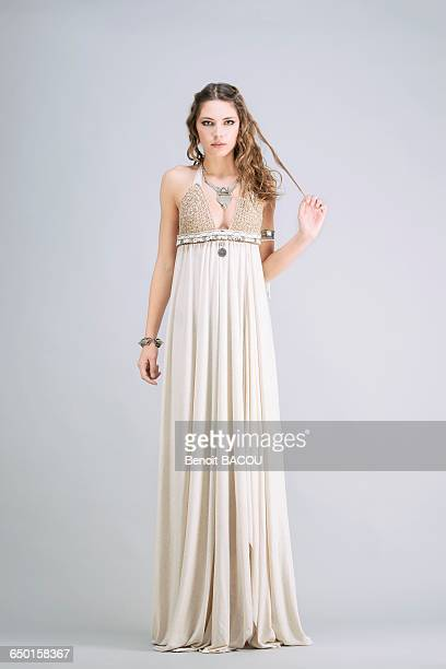 young woman standing, front, wearing a beige dress sanhadja - mystic goddess stock photos and pictures