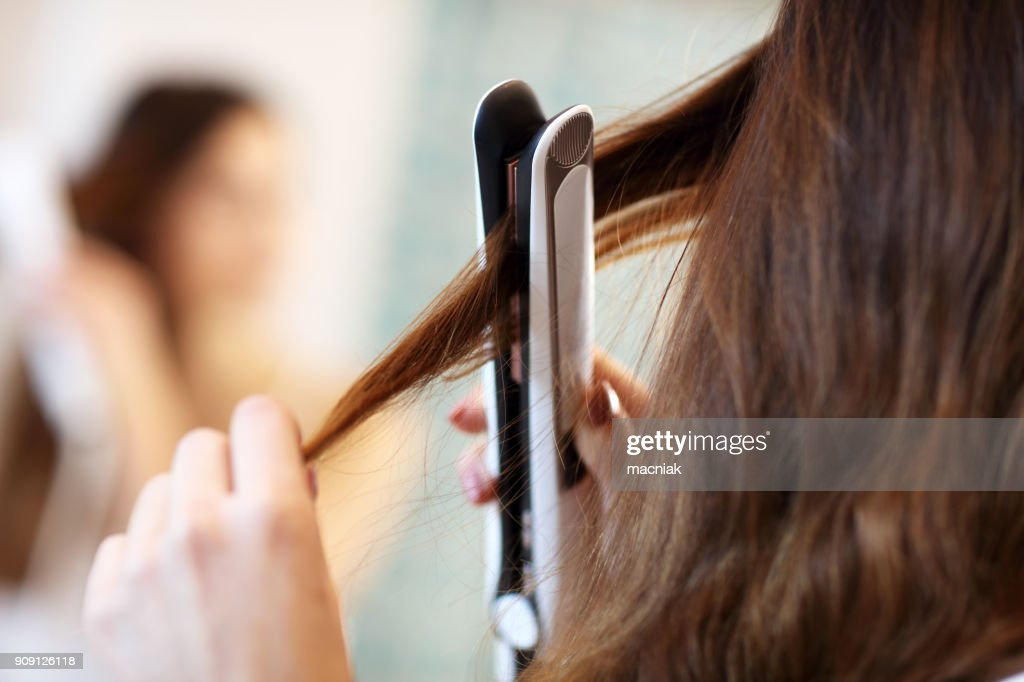 Young woman standing in bathroom in the morning : Stock Photo