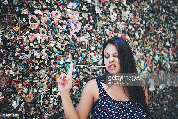 Young Woman Standing In Bubblegum Alley