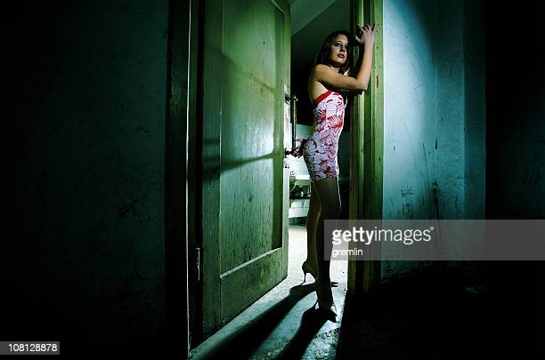young woman standing in door frame - mini dress stock pictures, royalty-free photos & images
