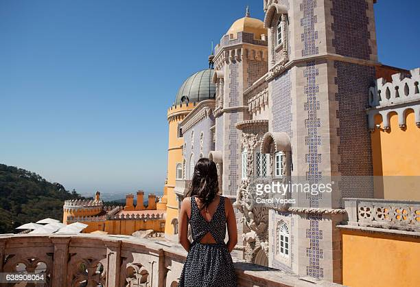 young woman standing in front of palace da pena, sintra,portugal - portugal stock pictures, royalty-free photos & images