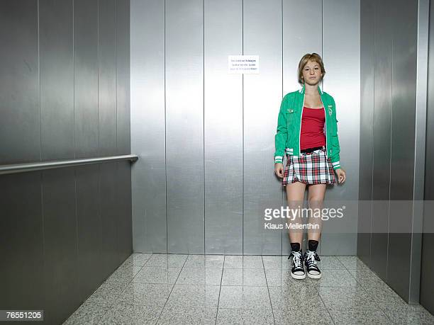 Young woman standing in lift