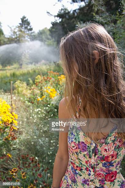Young woman standing in park