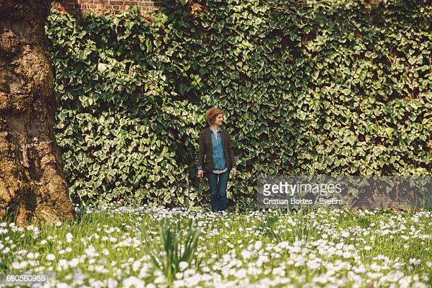 young woman standing in park - bortes stock pictures, royalty-free photos & images