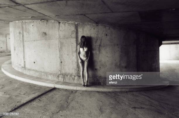 Young Woman Standing in Parking Garage, Black and White
