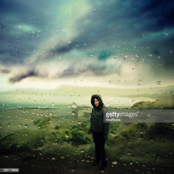 Young woman standing in rain