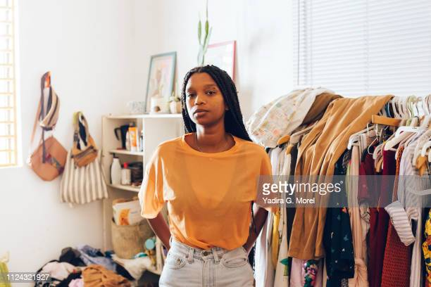 young woman standing in room - femme antillaise photos et images de collection