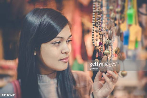 Young woman standing in shop.