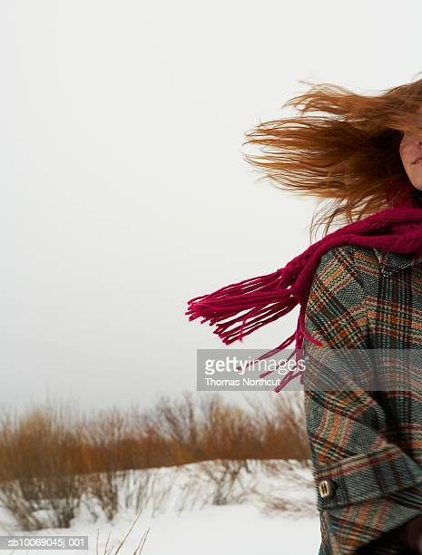 Young woman standing in snow