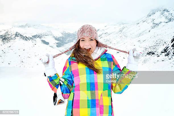 Young woman standing in the snowfall