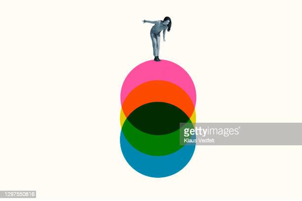 young woman standing on colorful circles - digital composite stock pictures, royalty-free photos & images