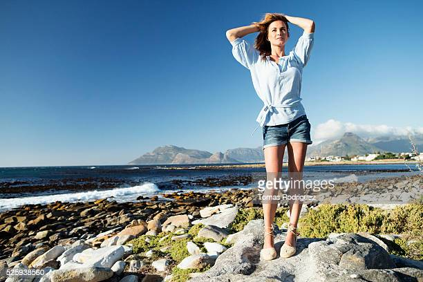 Young woman standing on sea shore